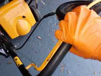 Lawn mower bail lever