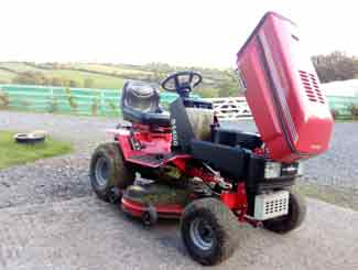 tractor mower with hood open