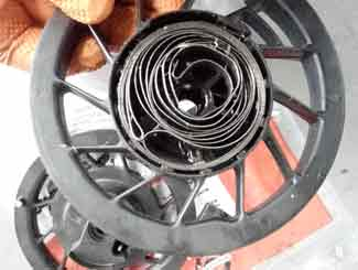Mower engine recoil spring and pulley