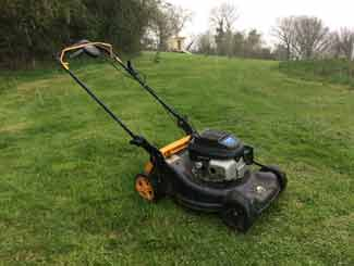Mower on hill