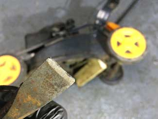 Mower blade bolt removal