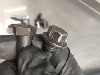mower bolt damage
