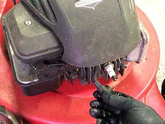 Removing lawn mower plug wire