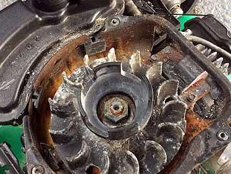 Mower flywheel pulley pawl receiver
