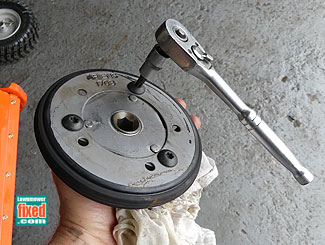 Snow blower friction wheel material